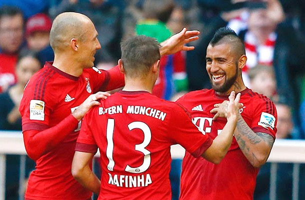 Munich's Robben celebrates with team mates after he scored against Cologne during their Bundesliga first division soccer match in Munich