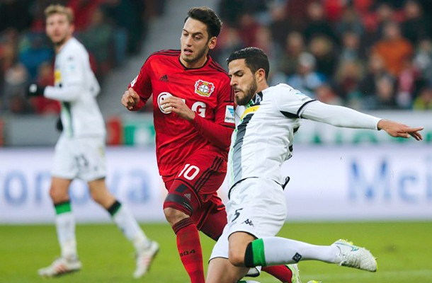 Bayer Leverkusen's Calhanoglu tackles Dominguez Soto of Borussia Moenchengladbach during their German first division Bundesliga soccer match in Leverkusen