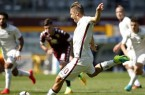 AS Roma's forward Francesco Totti scores a penalty during the It